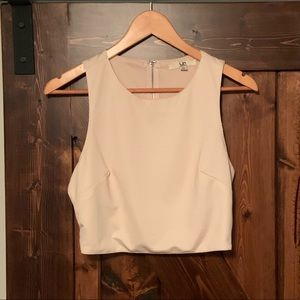 Cropped top with side cut outs and zippered back